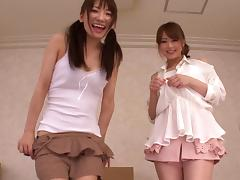 Two lovely Japanese chicks strip and please a guy with a footjob