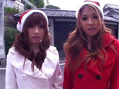 Two depraved Japanese Santa girls ride a shaft by turns in FFM reality