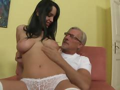 Dazzling brunette with natural tits giving her old guy stunning blowjob