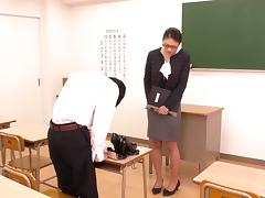 Japanese cutie wearing a miniskirt gives a footjob and a blowjob