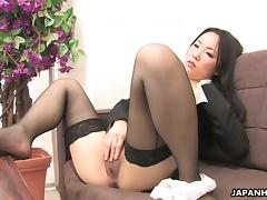 Ai Mizushima, wearing stockings, fingers her Japanese pussy