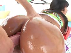 Latina MILF with long hair is oiled and her anal thrilled doggystyle