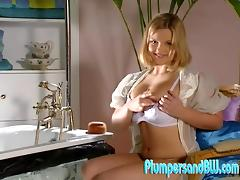 A chubby blonde uses her toy on her tits and shaved pussy