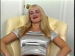 Masturbating blond slides fingers in cunt