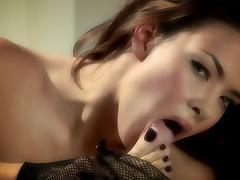 Sophia Santi, wearing fishnets, fingers her pussy in hardcore solo clip