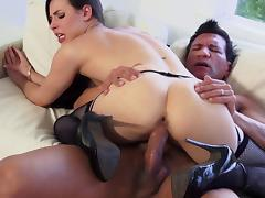 Dainty brunette cowgirl in fishnet stockings gives a blowjob then gets slammed hardcore