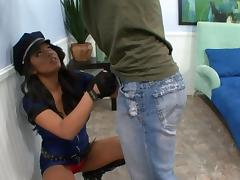 Hot brunette in cop uniform gives titjob and gets pussy fucked