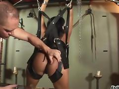 A busty Asian bitch gets fucked hard in a sex swing