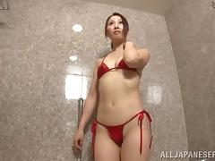 Dashing Japanese babe in a bikini gets her pussy stimulated with a vibrator in the bath tub