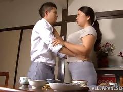 Delightful Asian bimbo with a hairy pussy moans as she gets drilled doggy style
