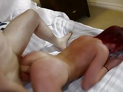 A redheaded babe in knee high socks cums all over his cock