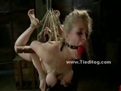 Gagged brunette is tied to a ladder flogged and has her ass cheeks hit with a riding crop