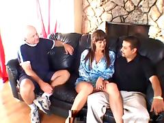 Hardcore sex clip with a brunette getting fucked in front of two men