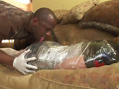 Gorgeous brunette with a shaved pussy being tortured and fucked by a stranger