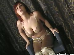 Redhead solo model Ania Colette  shows off her big tits