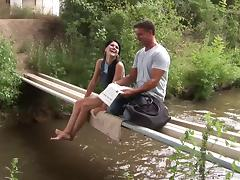 Romantic brunette teen getting stripped before being hammered hardcore on a bridge outdoor