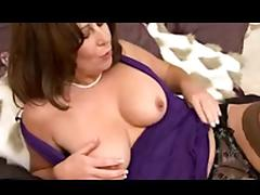 Horny mature in stockings masturbating