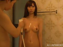 He cleans off his living doll and fondles her nice tits