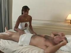 Tattooed brunette delivering fancy massage before getting nailed doggystyle with huge dick in reality shoot