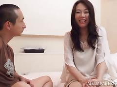 Adorable Japanese sex bomb gives her stud an endearing handjob