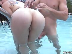 Longhaired slut with tattoos rammed hardcore by the pool side