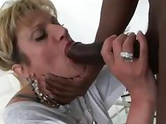 Breasty mature bimbo sucks a dick of a black guy