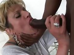 Breasty mature bimbo sucks a dick of a black guy