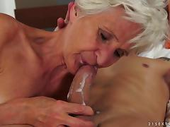 A granny uses her well aged pussy and mouth to get a guy off