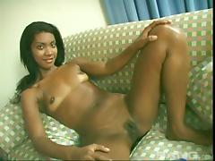 A sexy ebony babe lays back and fingers her wet pussy