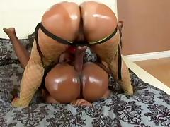 Chubby ebony lesbians get out the strapon and fuck like crazy