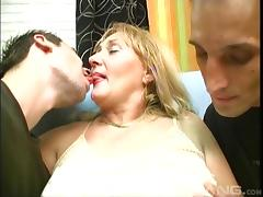 Mature granny pegging her partner with a strap on in a threesome