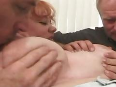 Fat redhead gets two cocks to suck and fuck