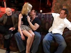 Men watch beautiful blonde suck and take cock on couch