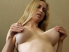 Hot blonde milf loves to pull on her big natural boobs