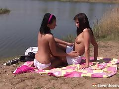 Fabulous college lesbians explore their moist holes by the lake