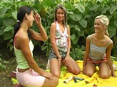 Chicks in sneakers fuck their big dildos on a farm