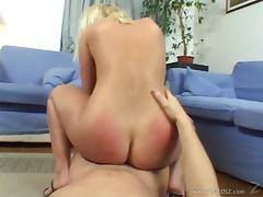 Voluptuous cowgirl getting her nice ass spanked before being fucked hardcore on the floor
