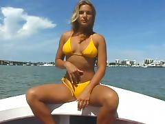 Showing off her pussy on a boat and sucking a cock