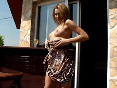 Beauty pours a glass of white wine over her perfect body