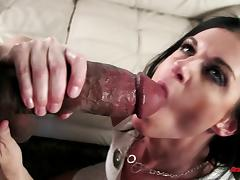 High-heeled porn star with a shaved pussy sucking a huge black cock