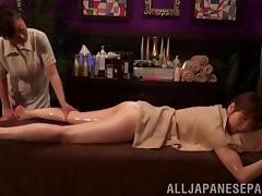 Lewd Japanese lesbian enjoys an oily massage with a happy ending