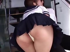 A naughty Japanese coed in uniform fucks on the stairs