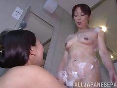Passionate Japanese lesbians are making out in this warm bathtub