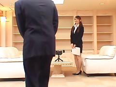 Sheer red lingerie under her business suit is a nice surprise
