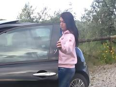 Vixenish cutie slides off her shoes after stepping into the driver's seat