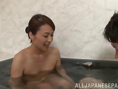 Stunning Asian cougar with small tits playing with a stranger's cock