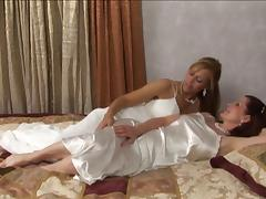 Foxy lesbian sex doll in stockings moans while getting throbbed with a toy