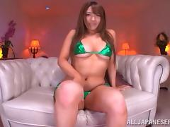 Her little shiny bikini comes off so the Asian girl can masturbate