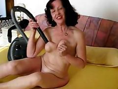 Mature Sucking Her Tits