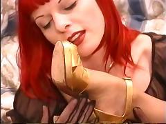 Redhead lesbo with nipple piercings removes stockings & sucks feet of goth slut